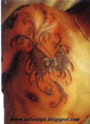 Butterfly tattoo on man chest