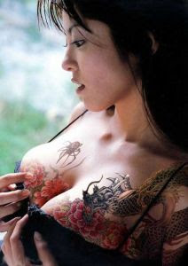 Beautiful japanese girl with 3D tattoo