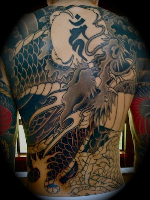 japanese dragon tattoos for men. dragon tattoos men arm.