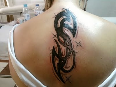 Simple Tribal Tattoo On Lower Back
