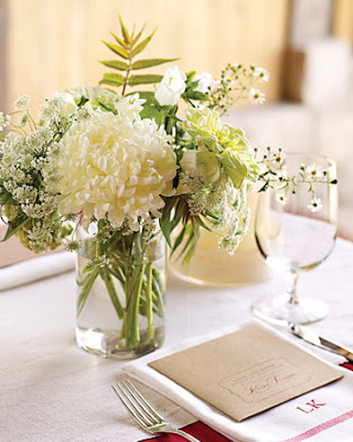 Small gorgeous centerpieces incorporating wild looking flowers