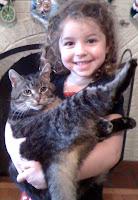 Frances holding cat named Mit