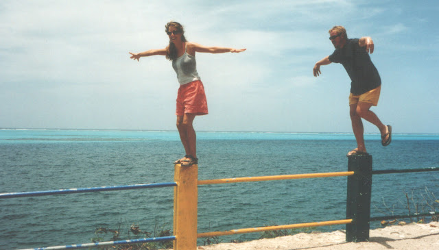 Standing on posts in Isla Providencia, Columbia with beautiful tropical water in background