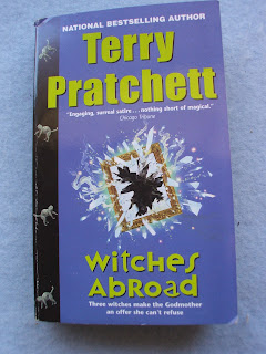 terry pratchett book review witches abroad wyrd sisters