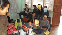 Teaching to orphan by volunteer