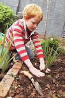 NAMC montessori activities world environment day boy gardening