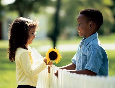 NAMC montessori teacher children's day activities appreciation boy giving girl flower