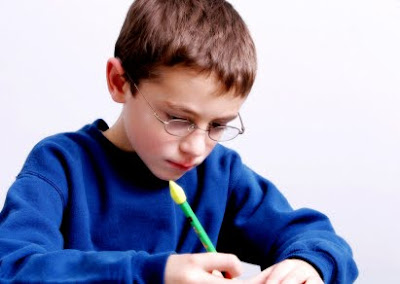 NAMC montessori activities for children's day boy writing a letter