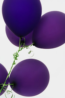 five purple balloons