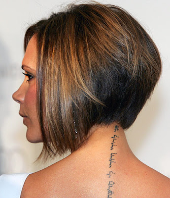 Her new short do uncovered a tattoo running down the back of her neck,