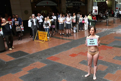 Tattooed Model Stands For PETA Protest