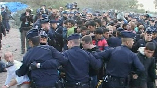 Police hold back migrants in Calais