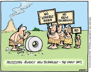 Cartoon showing people protesting the invention of the wheel titled Protesting against technology the early days