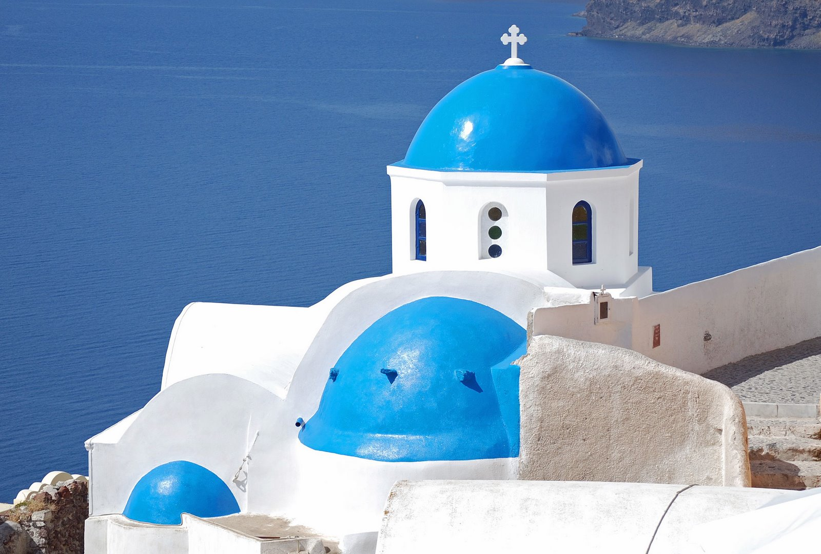 blue domed church in Santorini, Greece