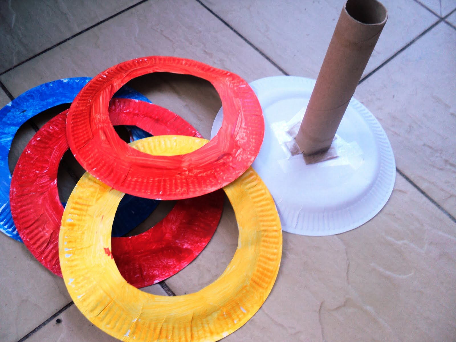 Ring toss games for kids - To Make The Stand I Just Cut Slits In The Bottom Of The Cardboard Tube And Flattened The Ends Then Taped It To The Reverse Side Of A Plate So It Would