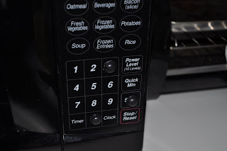 Sticky popped out buttons stuck onto the microwave on the 3, 0 and start buttons