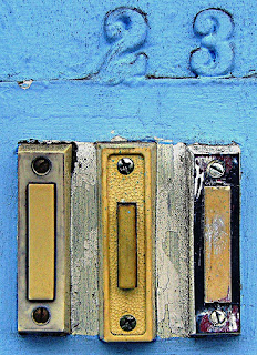 Photograph of the number 23 above some doorbells
