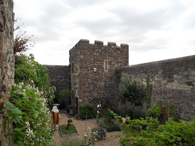 Mystery woman in garden of castle