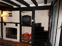 Inside Rye cottage showing entrance to stairs