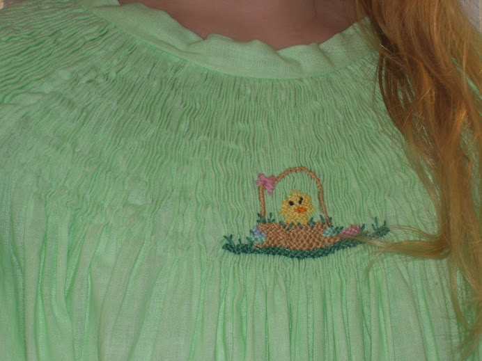 close up of green smocked bishop