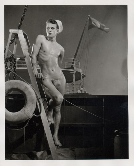 Many interesting photographs of (near) nude men with sailor's hats or blue ...