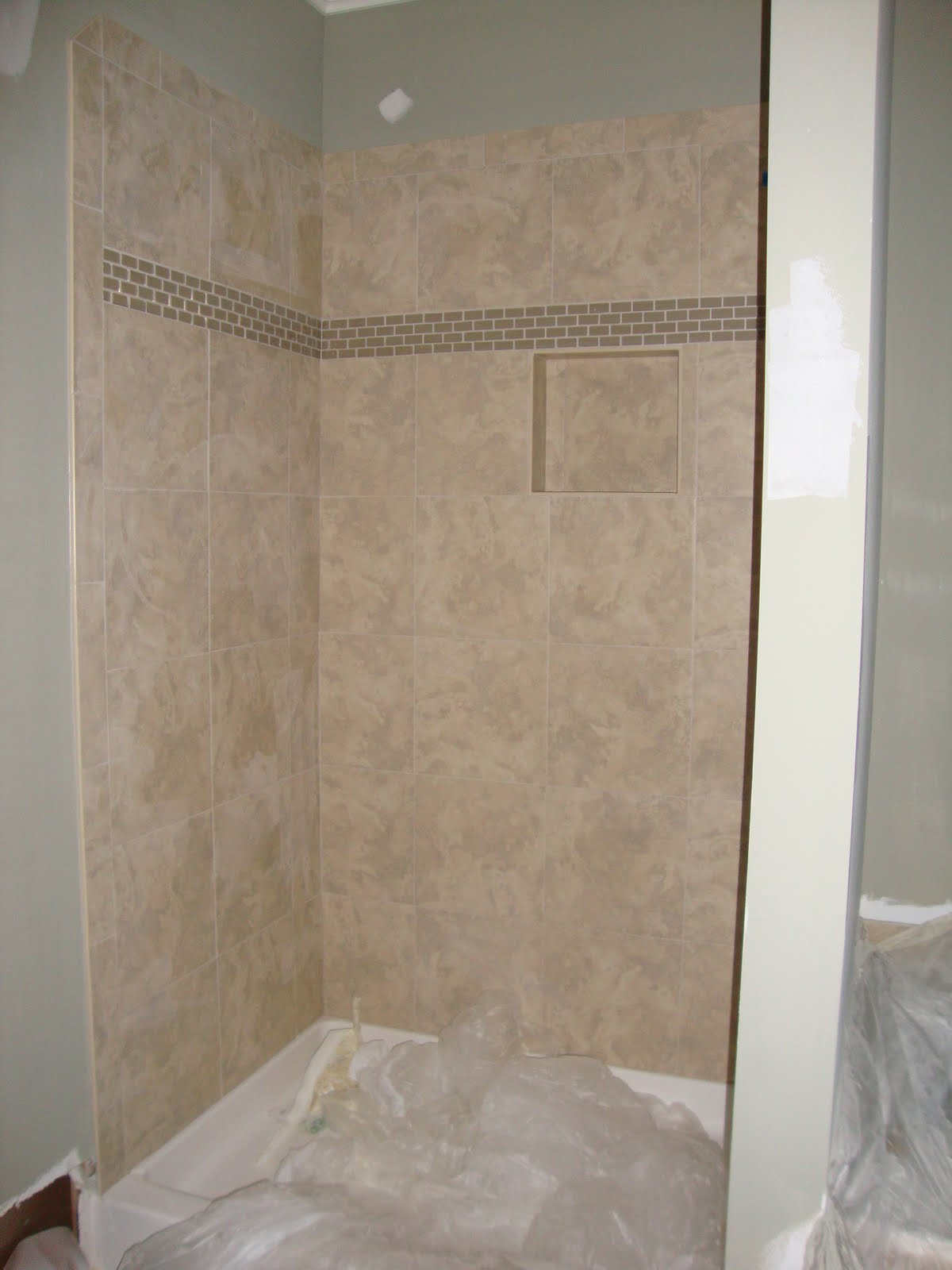 Home building project tile paint and cabinets for Tile master bathroom