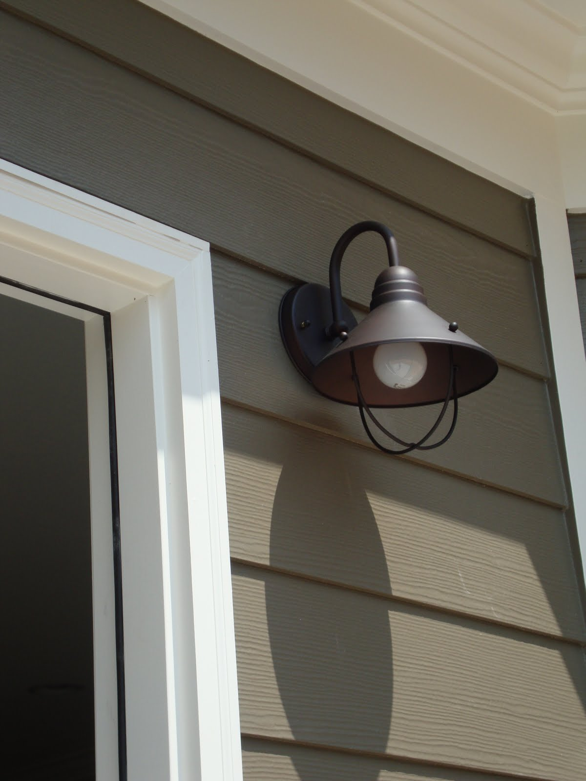 the back porch light is such a cute little transitional sconce also