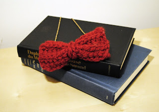 the Percy bow in cranberry red