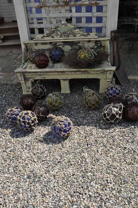OLD GLASS FISHERMANS BOUYS, TAKE THE NET OFF, THEY MAKE GREAT ART INDOORS OR OUT. TRY IT !