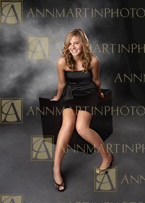 Dallas senior pictures poses in studio of senior girl in short formal dress