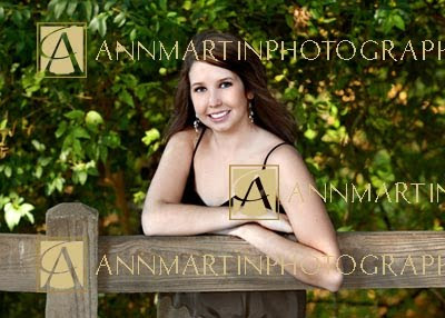 High School senior girl pictures pose outdoors on fence