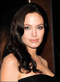 Angelina Jolie apparently breastfeeding on W magazine cover