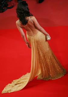 Mallika Sherawat stunning hot stills,Sexy Mallika Sherawat photos  in yellow