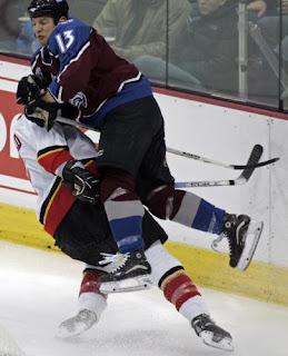 Colorado's Dan Hinote levels Calgary defender, Jordan Leopold, in a game November 21st, 2005