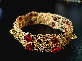 #GLSB04536 - Garnet Wire Crochet Bracelet. This Bracelet was created with no other but Red Glass Smooth Beads and Using the Single crochet technique , beads were combined with 28 gauge Non tarnish Gold Artistic Beading wires. Measures about 7 inches long and resizable upon request ~ Price + US$25.00 (S25)