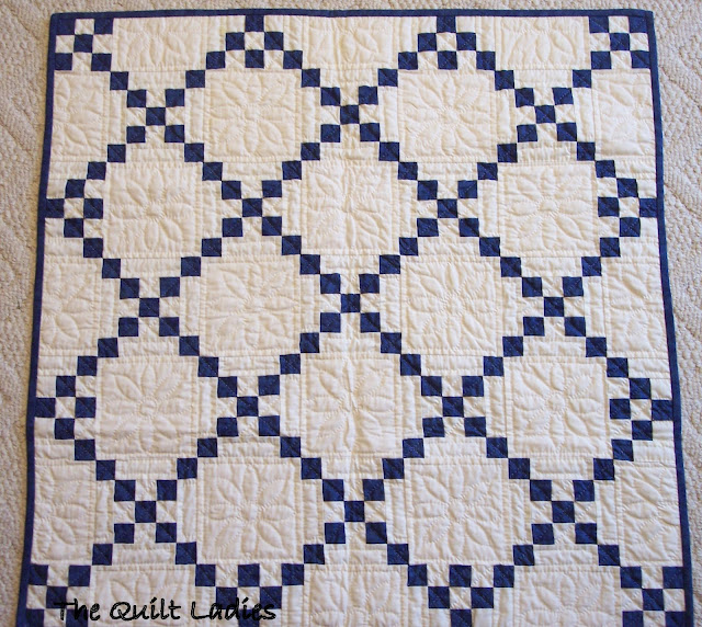 blue and white quilt in squares