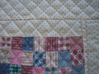 Quilt in Pink made of Squares hand quilted in pink thread