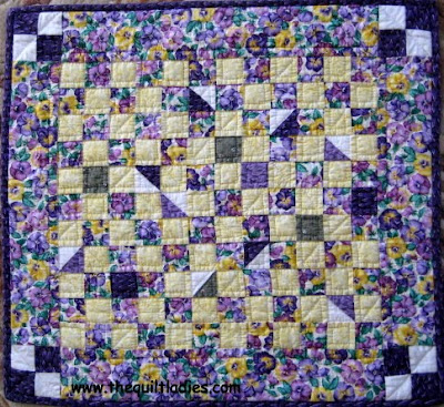 9 patch purple quilted table topper
