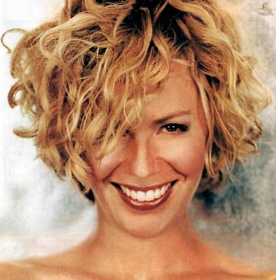 short haircuts for black women with curly hair. curly short hair styles for black women. Actres like Elizabeth Shue with