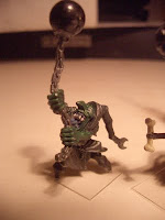 Goblin with ball and chain, standing on tip-toes.
