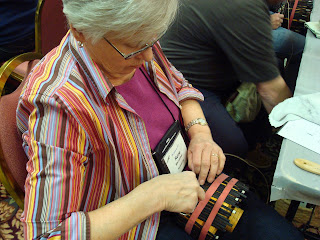 Rene works on a Nantucket Lightship basket purse in a class taught by Ann Lima