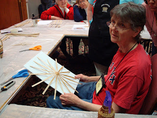 Dianne Stanton demonstrates the layout of the spokes in a cross-spoked, round bottomed Black ash woodsplint basket