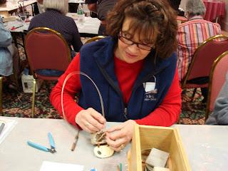 Mary Jo working on a miniature fishing creel in a Jo Ann Kelly Catsos basket class
