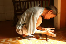 Vietnamese man building cot