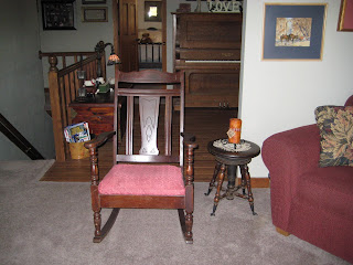 very dark wood with red upholstered seat antique rocking chair