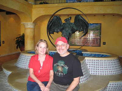 Jim & Deanna sitting in front of the Bacardi Bat logo