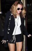 Miley Cyrus anteojos redondos. EL Sitio EL SUperficial publica una foto de .