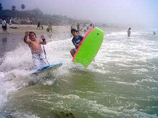 Aloha Beach Camp kids on thir boogie board enjoying the Malibu waves