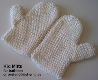 A pair of child-sized garter stitch mitts made of worsted weight cotton yarn.