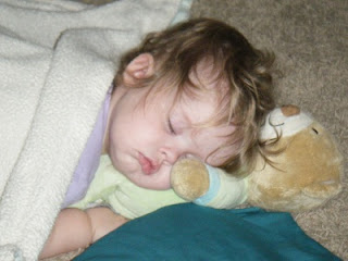 Asleep on her Taggies Bear